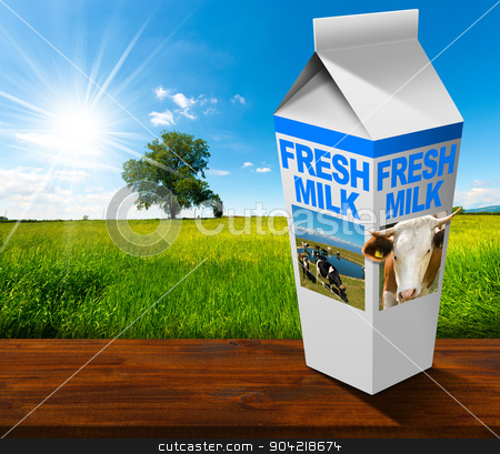 Fresh Milk Beverage Carton in Countryside stock photo, White packaging of fresh milk with text Fresh milk, in a countryside landscape with green grass and a tree on blue sky with clouds and sun rays by catalby