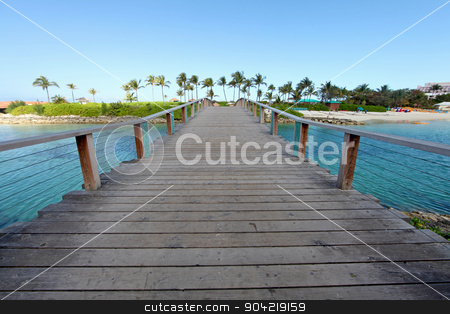 Bridge stock photo, A wooden bridge over water going over to a beach by Lucy Clark