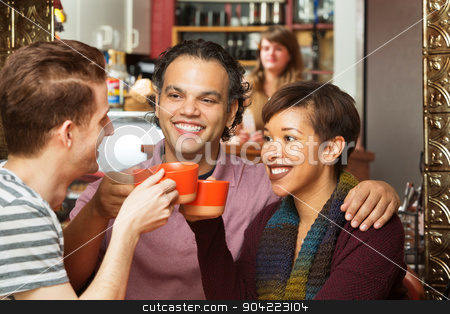 Friends Sharing Drinks stock photo, Diverse group of adults toasting with coffee cups by Scott Griessel