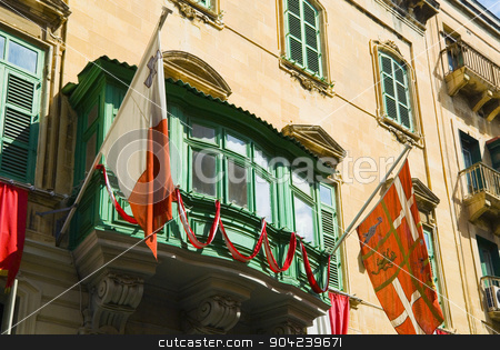 pims_20080607_ml0445 stock photo, Two flags attached on window of a building, Valletta, Malta by imagedb