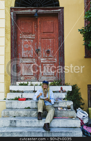pims_20080610_ml0146 stock photo, Man sitting on steps and painting, Athens, Greece by imagedb