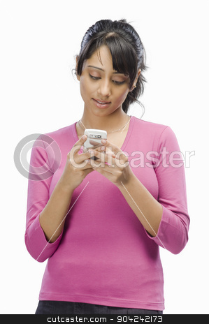 pims_20090330_sh0494.jpg stock photo, Young woman text messaging by imagedb