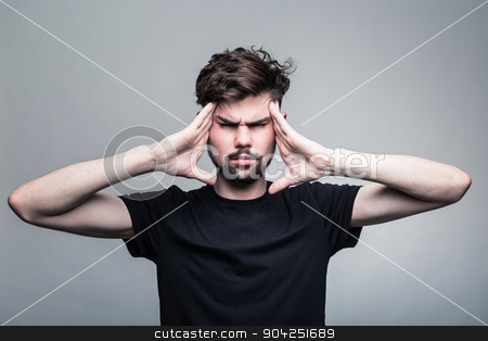 Man feeling pain,  with gray background stock photo, Young man feeling pain, frowning with hand on head with gray background by kkolosov