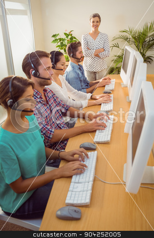 Manager supervising work in call center stock photo, Portrait of female manager supervising work in a call center by Wavebreak Media