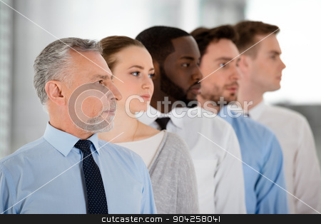 Concept for multi-ethnic business team stock photo, Multi-ethnic business team standing in a row and looking forward purposefully by Dmytro Sidelnikov