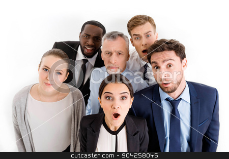 Concept for multi-ethnic business team stock photo, Multi-ethnic business team standing isolated on white looking up to camera in surprise by Dmytro Sidelnikov