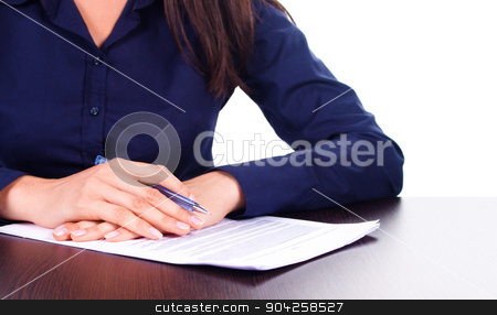 Woman signs a contract on a table, isolated over white stock photo, Woman in blue shirt signs a contract on a table, isolated over white by Ivanna Davydiuk