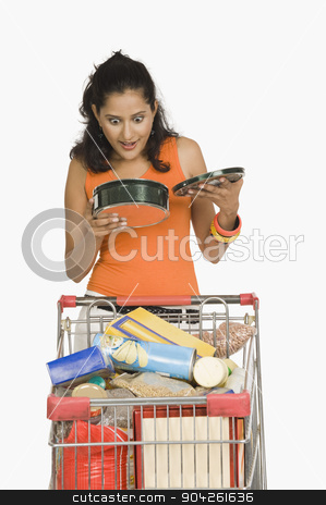 pims_20090812_sh0168.jpg stock photo, Woman holding a container and looking surprised by imagedb