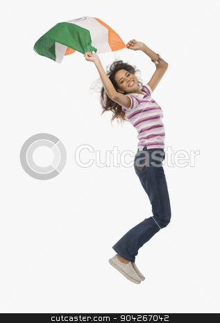 pims_20091216_sh0458.JPG stock photo, Portrait of a woman jumping with an Indian flag by imagedb