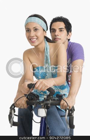 pims_20090622_sa0611.JPG stock photo, Couple on a bicycle by imagedb