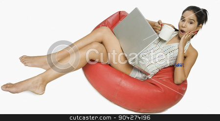 pims_20091109_rc0057.JPG stock photo, Woman using a laptop with a cup of coffee by imagedb