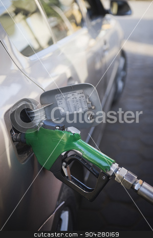 pims_20110404_sa0009.tif stock photo, Car being refueled at a gas station, New Delhi, India by imagedb