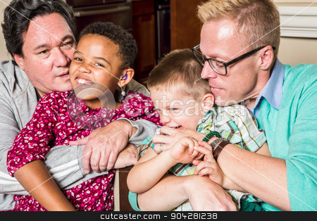 Parents Kissing Their Children stock photo, Gay parents kissing and hugging their children  by Scott Griessel