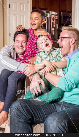 Gay Parents Tickling Their Children stock photo, Gay parents in the living room laugh with their children by Scott Griessel