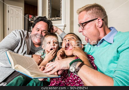 Cute Family Making Faces stock photo, Homosexual parents reading and making faces with son and daughter by Scott Griessel