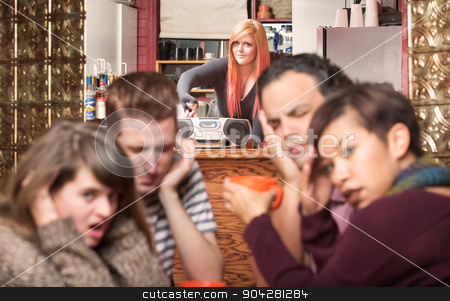 Worker Turning Up Loud Music stock photo, Customers covering ears while worker plays loud music by Scott Griessel