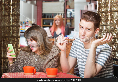 Girlfriend Talking at Phone with Boyfriend stock photo, Young woman laughing and holding phone of embarrassed man by Scott Griessel