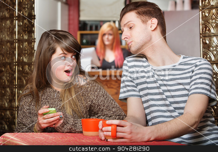 Woman Hiding Something on Phone stock photo, Woman holding phone as boyfriend looks over in cafe by Scott Griessel