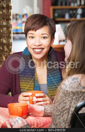 Happy Female Friends in Cafe stock photo, Smiling young adult with friend at coffee house indoors by Scott Griessel