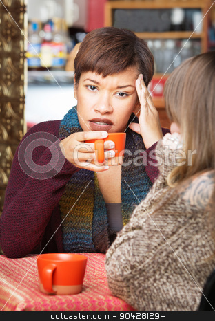 Lady with Headache in Cafe stock photo, Pretty young woman with headache at coffee house indoors by Scott Griessel