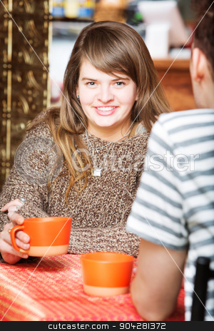 Happy Lady with Friend stock photo, Happy Caucasian female having coffee with friend by Scott Griessel