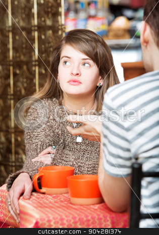 Daydreaming Lady in Cafe stock photo, Young woman with friend in cafe daydreaming by Scott Griessel