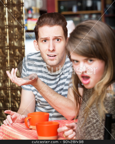 Disgusted Woman with Man stock photo, Disgusted young woman with frustrated man at cafe by Scott Griessel