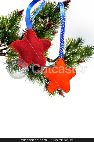 Christmas toys hanging on a Christmas tree on a white background stock photo, Christmas toys hanging on a Christmas tree on a white background. by timonko