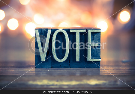 Vote Concept Metal Letterpress Type stock photo, The word VOTE written in vintage metal letterpress type on a soft backlit background. by Jason Enterline