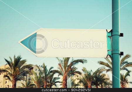 Blank Road Sign stock photo, Blank Road Sign With a Blue Sky and City Buildings by Sergey Burtsev