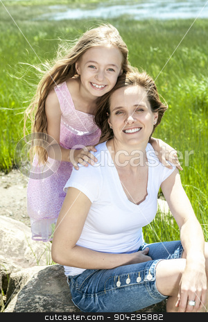 Young mother and her young daughter fun time together outdoors. stock photo, A Young mother and her young daughter fun time together outdoors. by Louis-Paul St-Onge