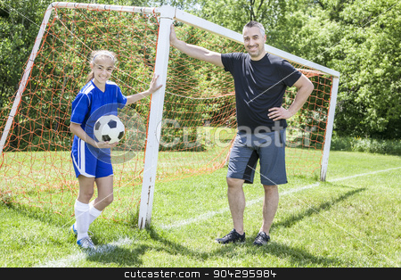 teenager girl with father play soccer stock photo, A teenager girl with his father play soccer in a beautiful day by Louis-Paul St-Onge