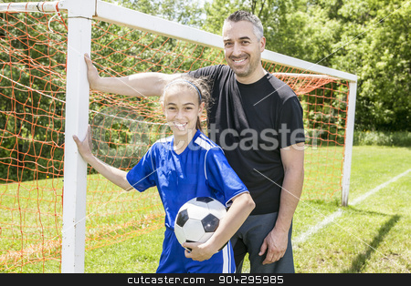 teenager girl with his father play soccer in a beautiful day stock photo, A teenager girl with his father play soccer in a beautiful day by Louis-Paul St-Onge