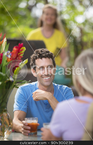 Handsome Man with Friend stock photo, Handsome man having drinks with friend outdoors by Scott Griessel