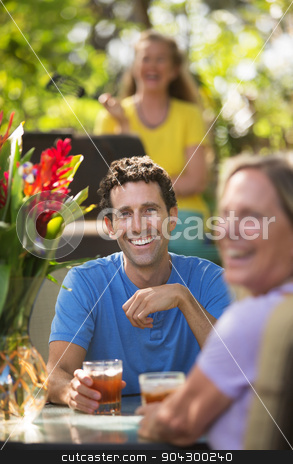 Happy Man and Woman in Maui stock photo, Happy man and woman on with drinks in Maui by Scott Griessel