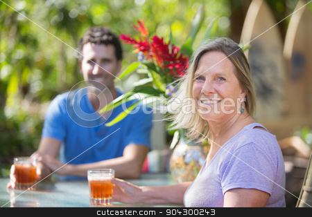 Attractive Couple on Vacation stock photo, Attractive man and woman on vacation at table by Scott Griessel