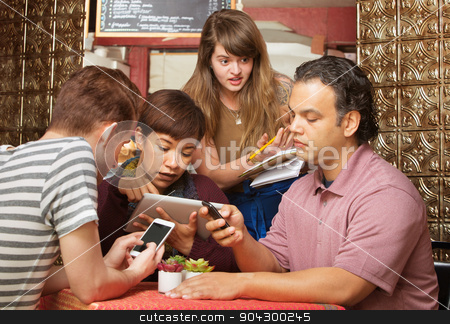 Annoyed Server with Distracted Customers stock photo, Annoyed cafe hostess annoyed with distracted customers by Scott Griessel