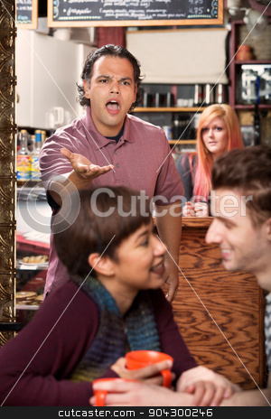 Upset Man and Cheating Girlfriend stock photo, Young affectionate couple and jealous man in cafe by Scott Griessel