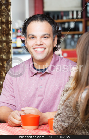 Handsome Man Having Coffee stock photo, Smiling handsome African American man having coffee with friend by Scott Griessel