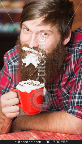 Man with Foam on Beard stock photo, Happy young man with coffee and whipped cream on beard by Scott Griessel
