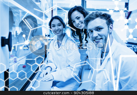 Composite image of science graphic stock photo, Science graphic against science students using pipette in the lab by Wavebreak Media
