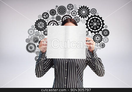 Composite image of businesswoman showing a white card in front o stock photo, Businesswoman showing a white card in front of her face against grey background by Wavebreak Media
