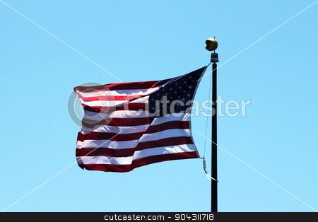 USA Flag stock photo, USA flag with a blue sky in the background. by Henrik Lehnerer