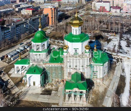 Aerial view on temple chapel in honor of Lady Day stock photo, Tyumen, Russia - April 4, 2015: Aerial view on temple chapel in honor of the Lady Day by Aikon