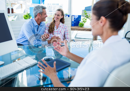 Pregnant woman and her husband discussing with doctor stock photo, Pregnant woman and her husband discussing with doctor in clinic by Wavebreak Media