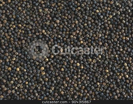 Black Peppercorns stock photo, Indian organic black peppercorns background by Vinod Pillai