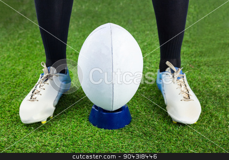 Rugby player ready to make a drop kick stock photo, Low angle view of a rugby player ready to make a drop kick by Wavebreak Media