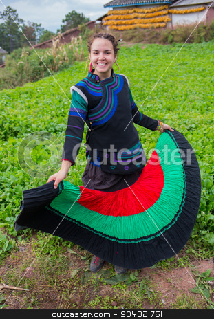 Woman in national costume with family stock photo, Woman in national costume with family in the china by Vassiliy Kochetkov
