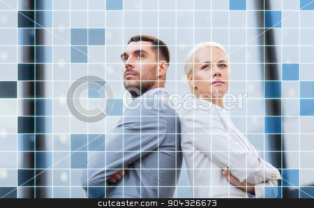 businessman and businesswoman outdoors stock photo, business, partnership, success and people concept - businessman and businesswoman standing over office building and grid background by Syda Productions