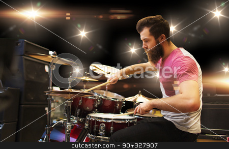 male musician playing cymbals at music concert stock photo, music, people, musical instruments and entertainment concept - male musician playing cymbals at rock concert by Syda Productions